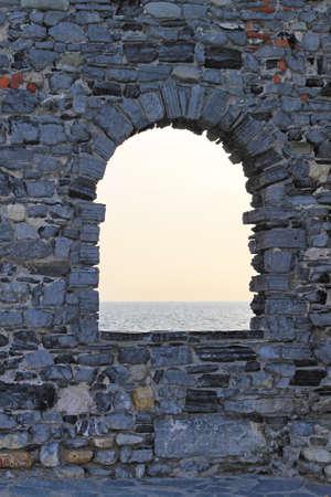 Arch stone window with Mediterranean sea view Stock Photo - 18295323