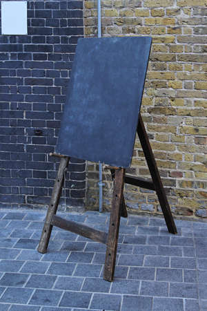 Old style black board at easel tripod Stock Photo - 18307210