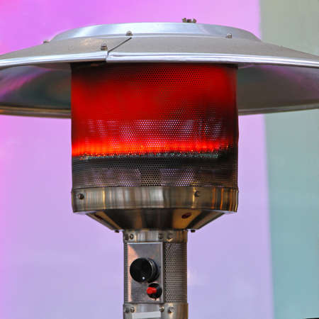 Outdoor gas heater patio lamp burning red Stock Photo - 18307170