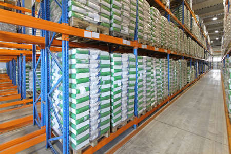 Sacks and bags of goods in warehouse row shelves Stock Photo - 18352964