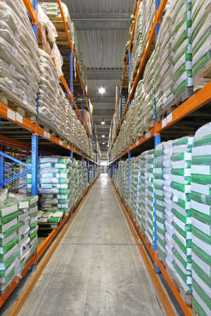 Bags and sacks in shelves row of warehouse photo