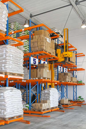 High rack stacker forklift in distribution warehouse photo
