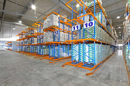Rows of shelving system in distribution warehouse photo