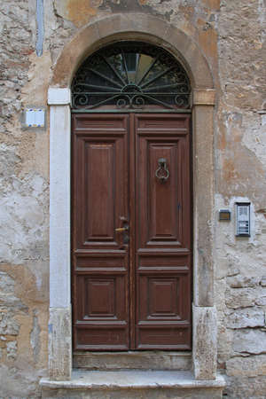 Medieval arch wooden door at old house Stock Photo - 18397893