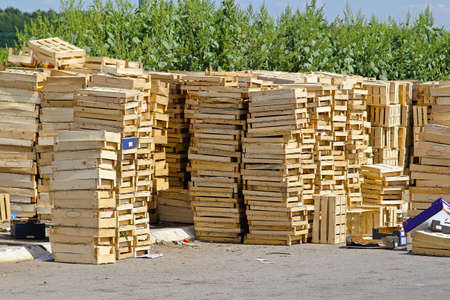 Piles and staks of wooden crates for fruits Stock Photo - 18425485