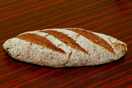 Whole sourdough rye bread at the table Stock Photo - 18425484