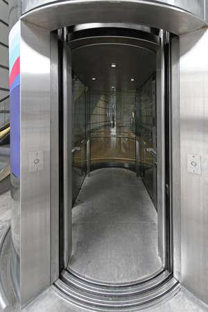 slide glass: Open slide door at modern glass elevator
