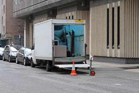 Moving van with loading ramp at London streets photo