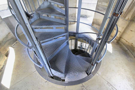 Spiral metal stairway in old tall tower Stock Photo - 18584671