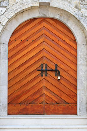 Wooden arch door at castle in Budva Montenegro Stock Photo - 18638092