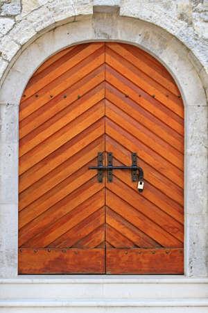 Wooden arch door at castle in Budva Montenegro Stock Photo - 18638092