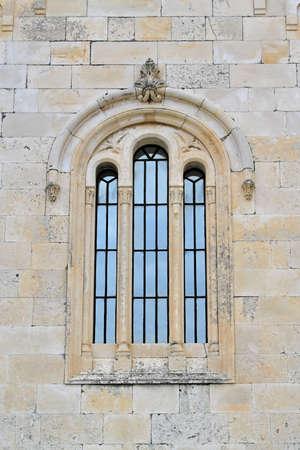 church window: Three arch windows at medieval stone church in Montenegro Stock Photo