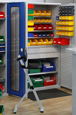 Colourful plastic bins and trays in storage room Stock Photo - 18707972