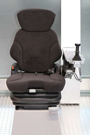 Ergonomic Seat with Joystick Controls for Construction Machinery Stock Photo - 18701694
