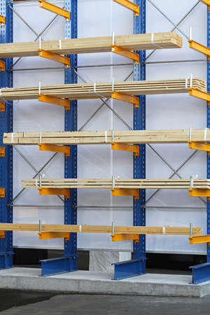Warehouse shelves loaded with wood plank boards Stock Photo - 18707973