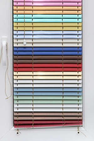 Closed colourful aluminum shades and blinds for window Stock Photo - 18791885