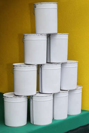 White bucket metal tin containers with paint photo