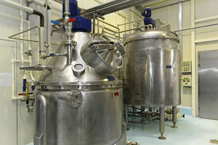 Interior of dairy factory with fermentation tank Stock Photo