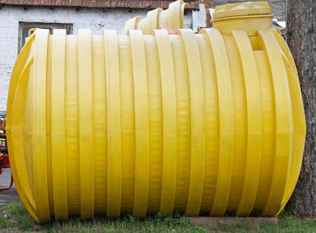 Plastic yellow storage tank for underground installation Stock Photo - 18791883