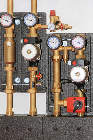 Central heating unit with pump valves and gauges Stock Photo - 18874061