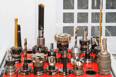 Collection of milling and drilling tools for CNC machine Archivio Fotografico