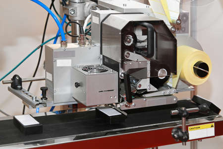 conveyer: Label printer and applicator machine at conveyer belt