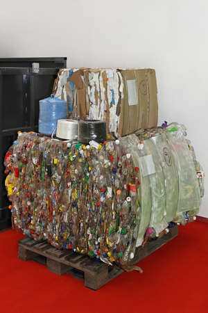compacted: Old paper and plastic bottles compacted for recycle