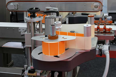 packaging equipment: Automated labeling machine equipment with conveyor belt Stock Photo