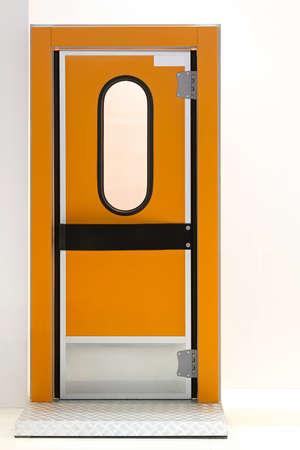 insulated: Orange insulated door at industrial fridge reefer Stock Photo