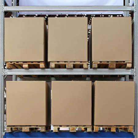 Six carboard boxes at pallets in distribution warehouse photo