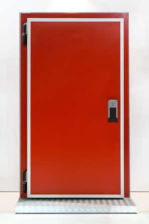 reefer: Insulated red door at industrial refridgerator reefer