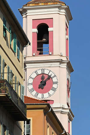 nice weather: Pink clock tower landmark in Nice France Stock Photo
