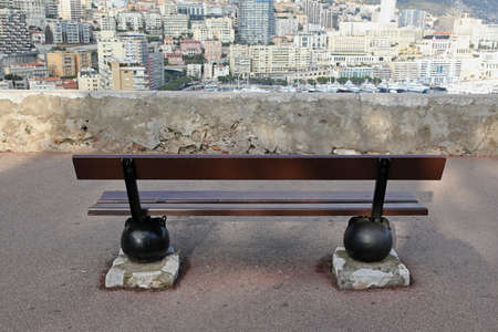 Wooden bench with view over Monaco town Stock Photo - 19139425