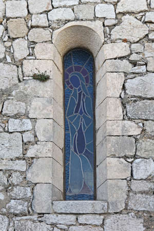 Blessed Virgin Mary window at stone church Stock Photo - 19139427