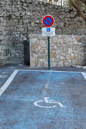 Blue parking place reserved for handicapped only Stock Photo - 19139595