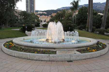 Round water fountain in Monte Carlo park Stock Photo - 19139433