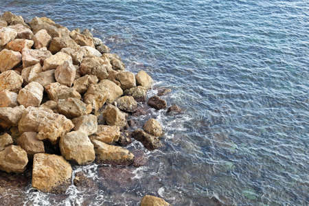 Mediterranean sea and bunch of big rocks at coast Stock Photo - 19139432
