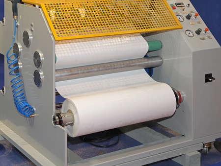 offset: Roll of paper in printing press machine Stock Photo