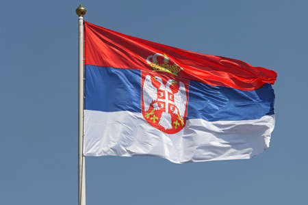 Serbian national flag with eagles and crown Stock Photo - 19263888