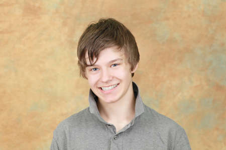 Hansome young teenage boy with modern hair style photo