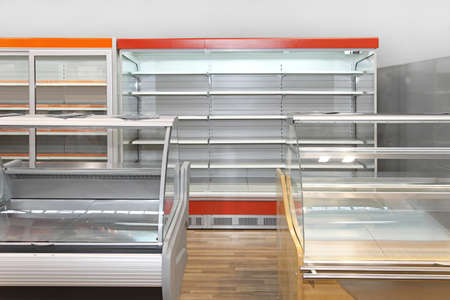 Empty retail shelves and showcases in grocery store Stock Photo - 19339060