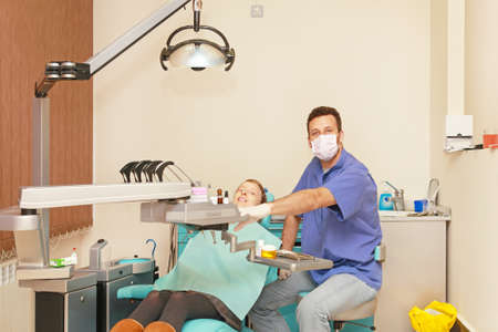 Dentist doctor and patient in dental clinic photo