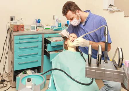 dentist drill: Dentist doctor drilling tooth in dental clinic Stock Photo
