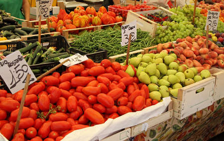 Big farmers market stall filled with organic fruits and vegetables photo