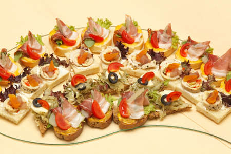 Canapes and one bite appetizers at tray Stock Photo - 19611468