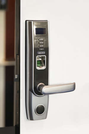 Biometric fingertip lock at modern home door photo