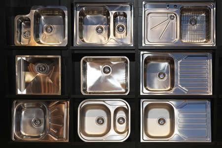 Many new stainless steel sinks plumbing fixture photo