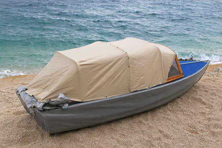 duct tape: Small duct tape dinghy boat at beach Stock Photo
