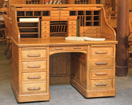compartments: Vintage style secretary wooden desk with rolltop Stock Photo