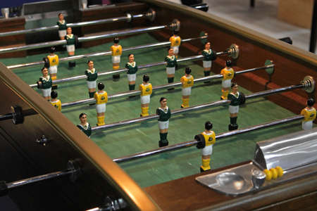 play popular: Vintage style table top football in bar